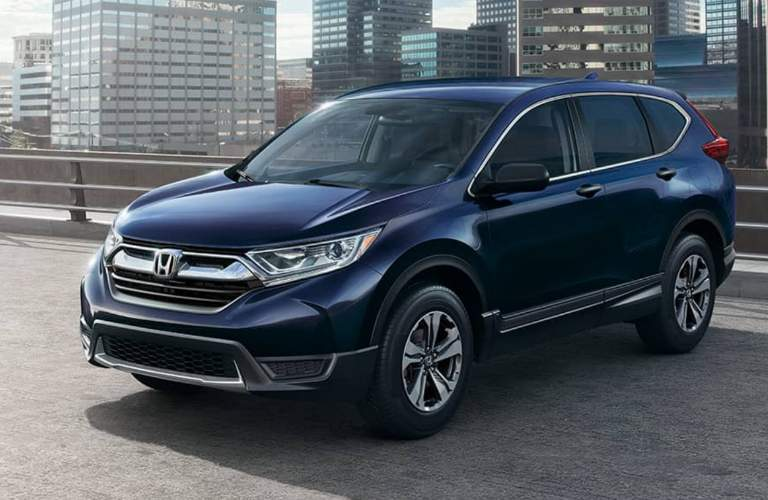 2018 Honda CR-V in blue paint color parked in the city
