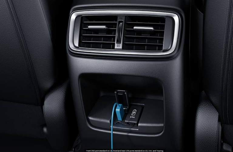 USB port in the Honda CR-V with phone charger plugged into it