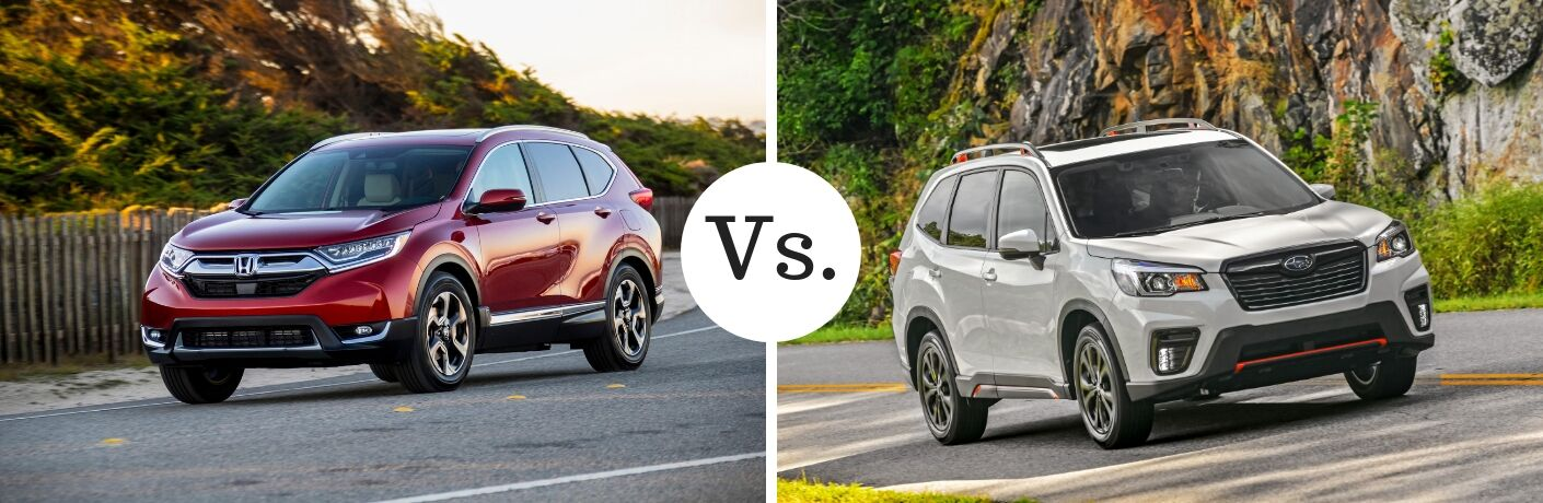 red honda cr-v compared to white subaru forester