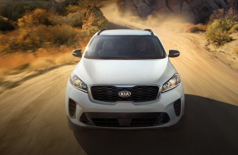 2020 Kia Sorento exterior front fascia going fast on dirt road kicking up dust