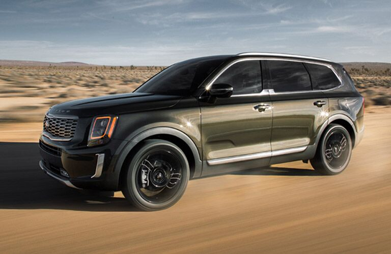 Green 2020 Kia Telluride Front and Side Exterior on Desert Trail