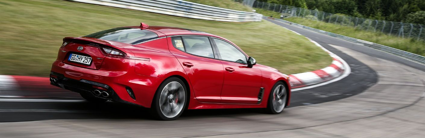 A right profile photo of the 2018 Kia Stinger GT going round a racetrack.