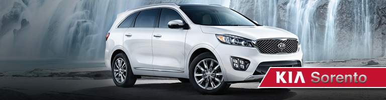 white Kia Sorento in front of waterfall