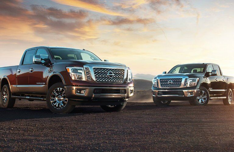Two 2017 Nissan Titan models next to each other