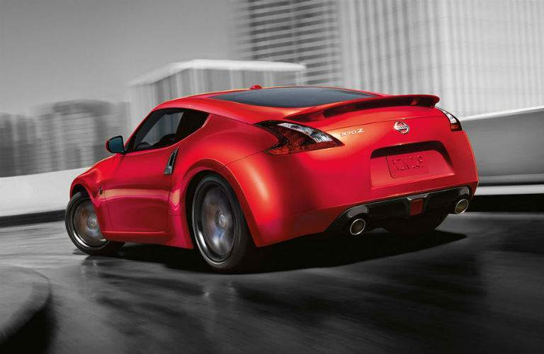 Rear view of red 2018 Nissan 370Z going around curve