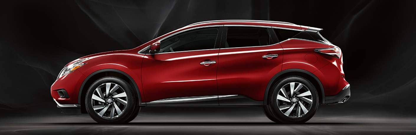 Red 2018 Nissan Murano in front of black background