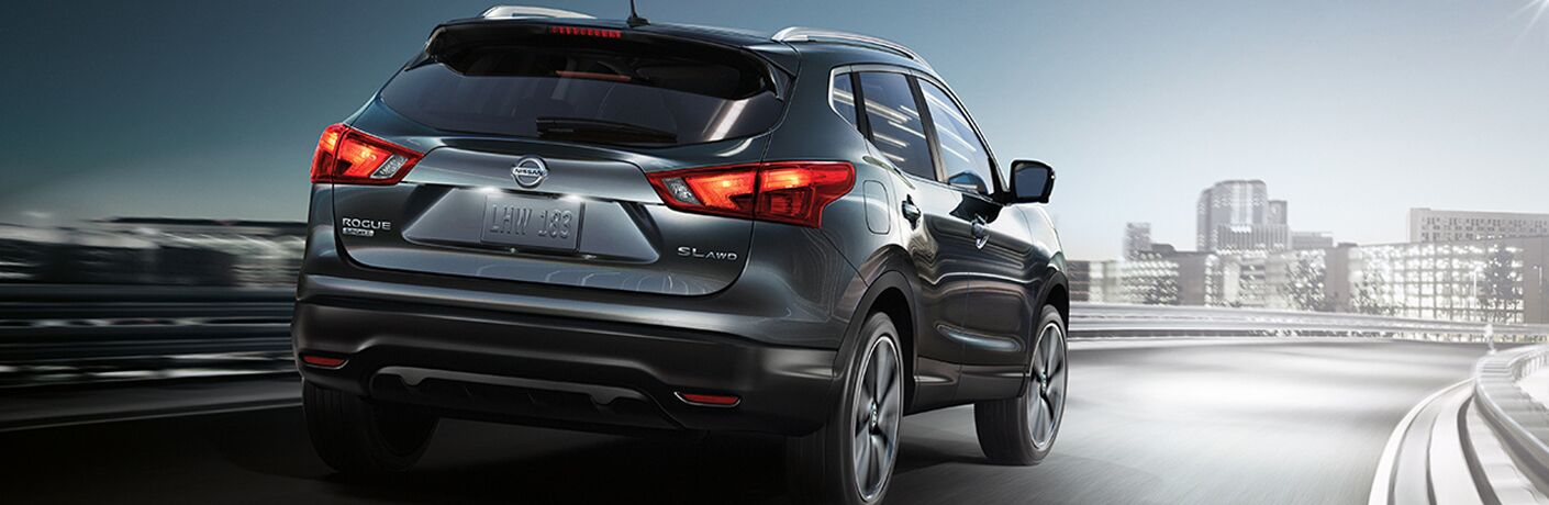 rear view of dark gray nissan rogue sport