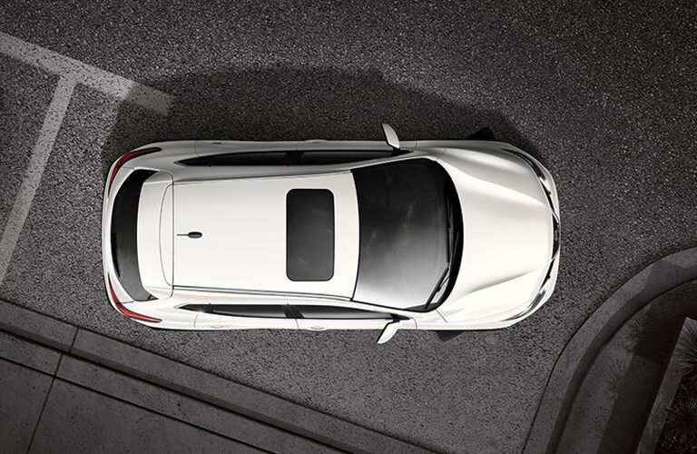 top view of white nissan rogue sport with sunroof