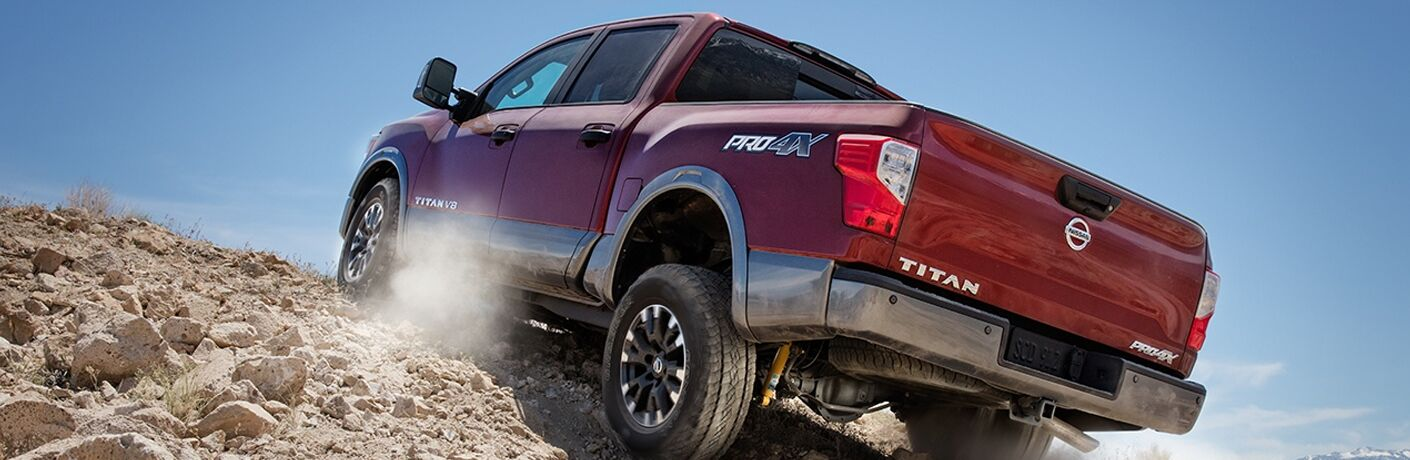 2018 Nissan Titan driving on rocks.