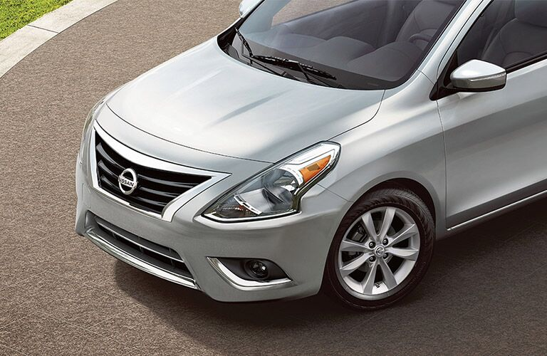 front end of silver nissan versa