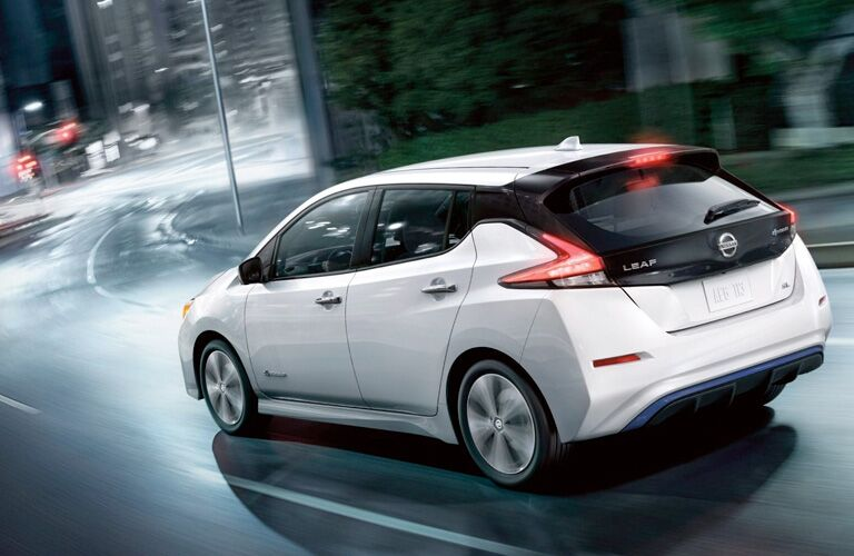 2019 Nissan Leaf driving down a road at night