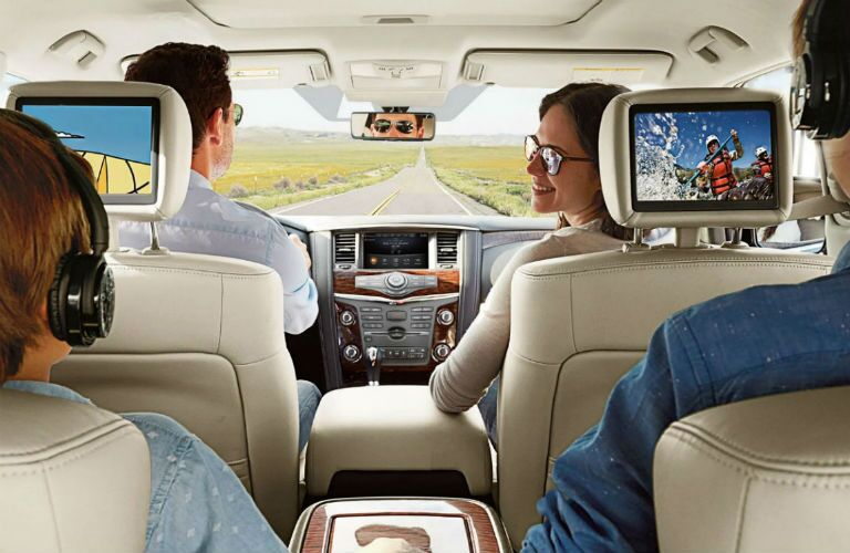 Family enjoying the optional rear seat entertainment system of the 2019 Nissan Armada