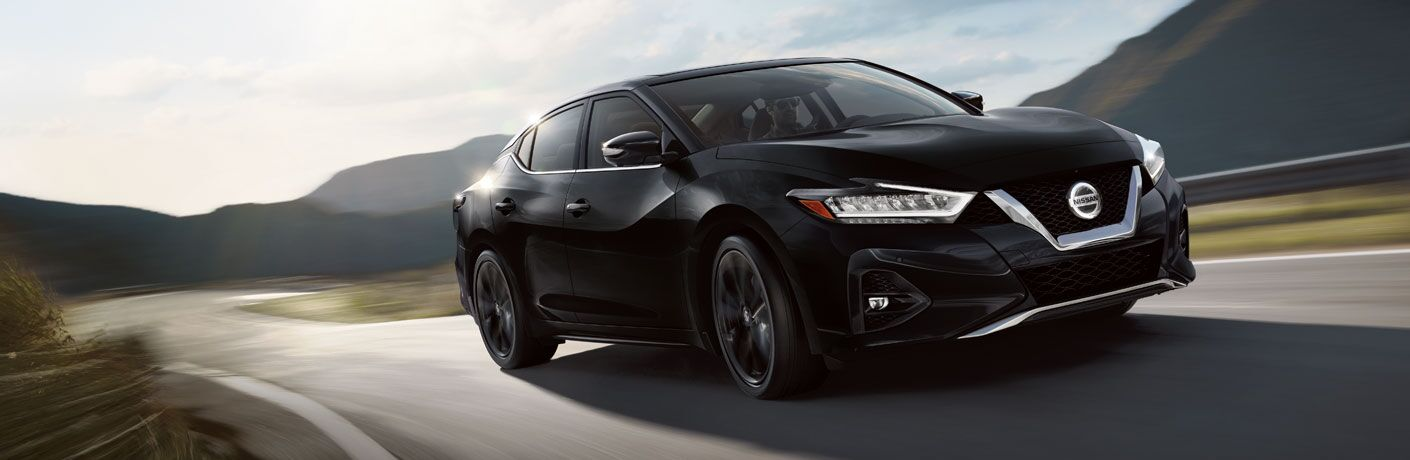 2020 Nissan Maxima driving down a winding rural road
