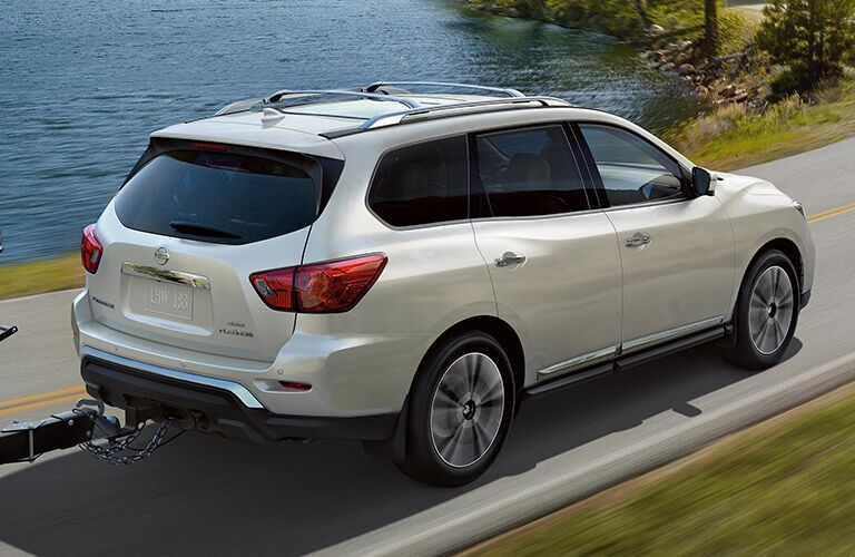 2020 Nissan Pathfinder driving by a body of water