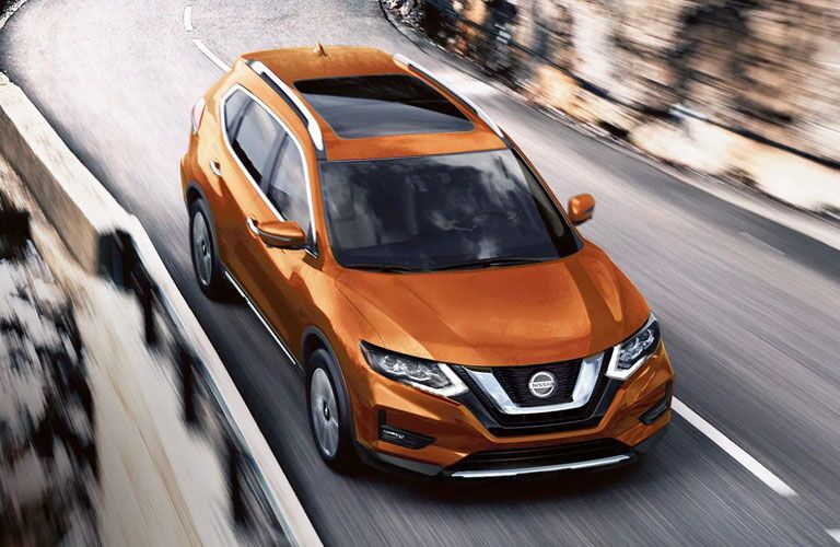 2020 Nissan Rogue driving down a mountain road