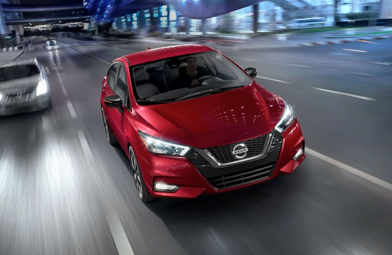 2021 Nissan Versa driving down a busy highway