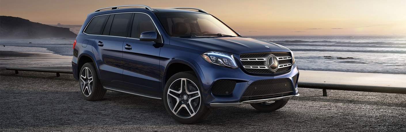 blue Mercedes-Benz GLS SUV parked on an ocean beach