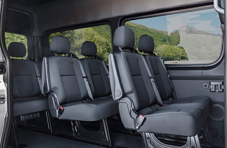 seats inside a Mercedes-Benz Sprinter Van for passengers