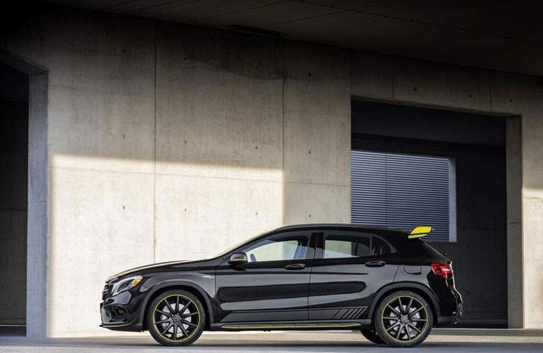 side view of black Mercedes-Benz GLA with spoiler wing