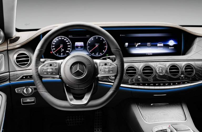 close up view of steering wheel and information screen inside the Mercedes-Benz S-Class
