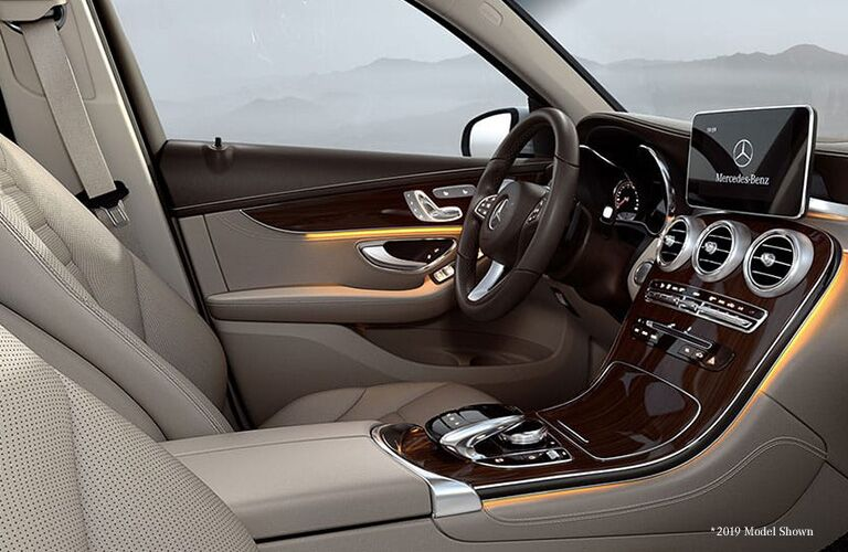 2020 Mercedes-Benz GLC interior shot from passenger seat showing console dashboard steering wheel and view through windows