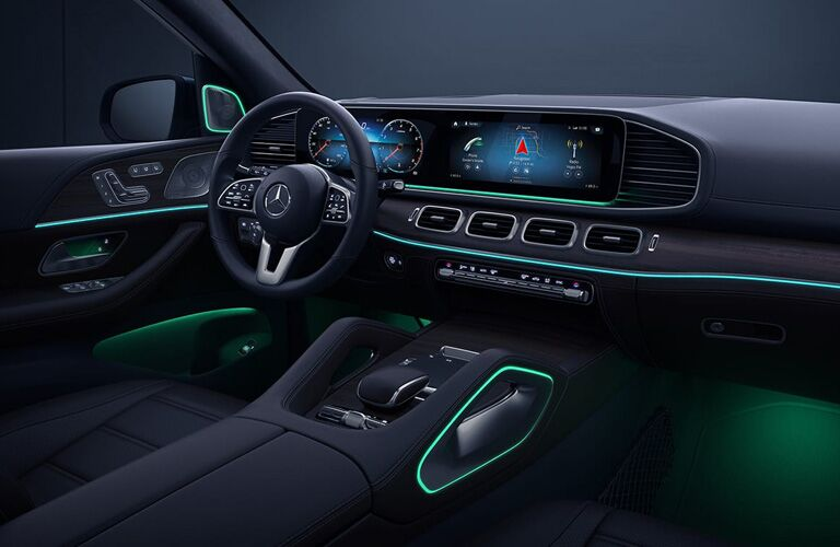 2020 Mercedes-Benz GLE interior shot showing ambient lighting dashboard steering wheel and driver seat