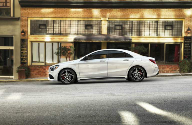 side view of white Mercedes-Benz CLA parked on a road