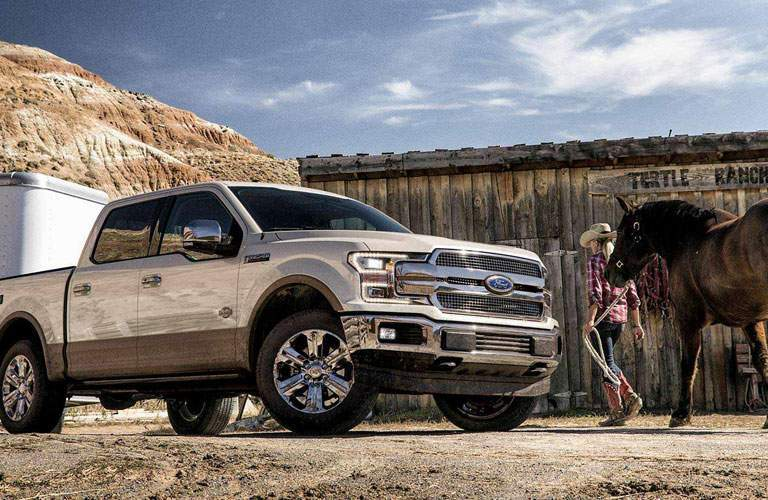 Rancher Leading Her Horse To The Livestock Trailer Hitched Behind 2018 Ford F 150