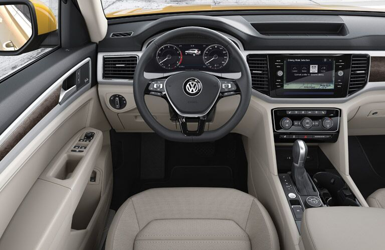 Dashboard and light grey front seats in 2019 Volkswagen Atlas