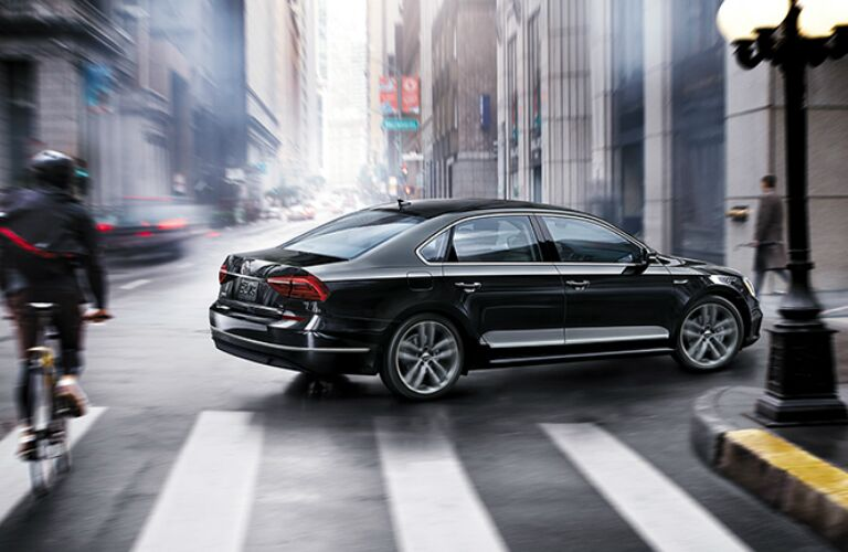 Black 2019 Volkswagen Passat Making a Right Turn on a City Street