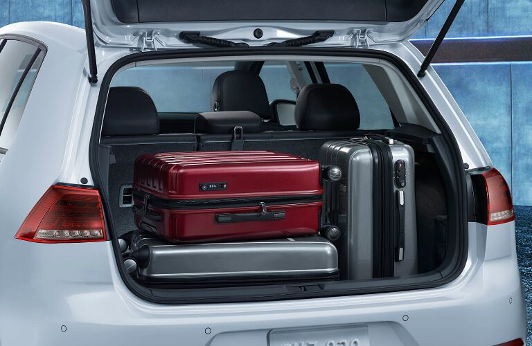 Luggage in the cargo area of a white 2019 Volkswagen e-Golf
