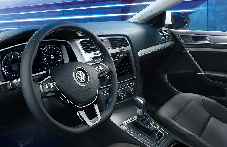 Dashboard and black front seats in 2019 Volkswagen e-Golf