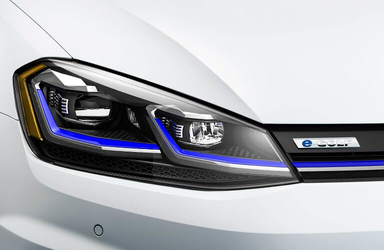 Headlight and badge on white 2019 Volkswagen e-Golf