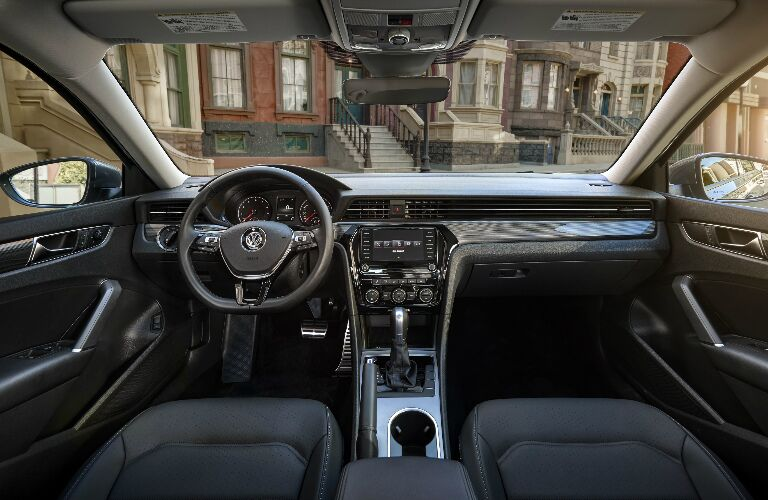 Dashboard and dark grey front seats in 2020 Volkswagen Passat