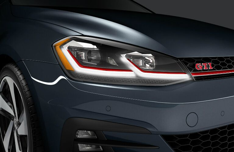 Headlights, grille, and badge on grey 2019 Volkswagen Golf GTI