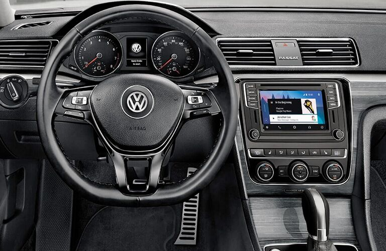 Close up of the steering wheel and the touch screen in the 2018 Volkswagen Passat