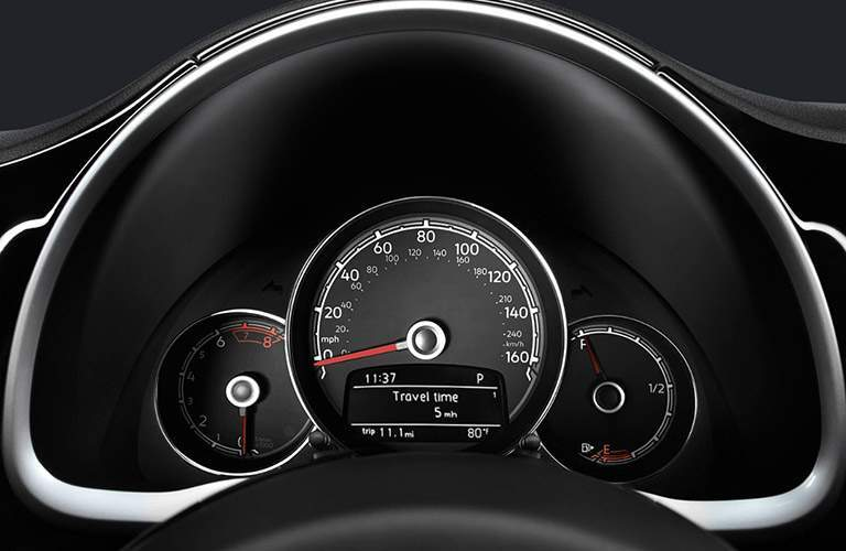 Instrument cluster of 2018 Volkswagen Beetle with speedometer and gas gauge prominently shown