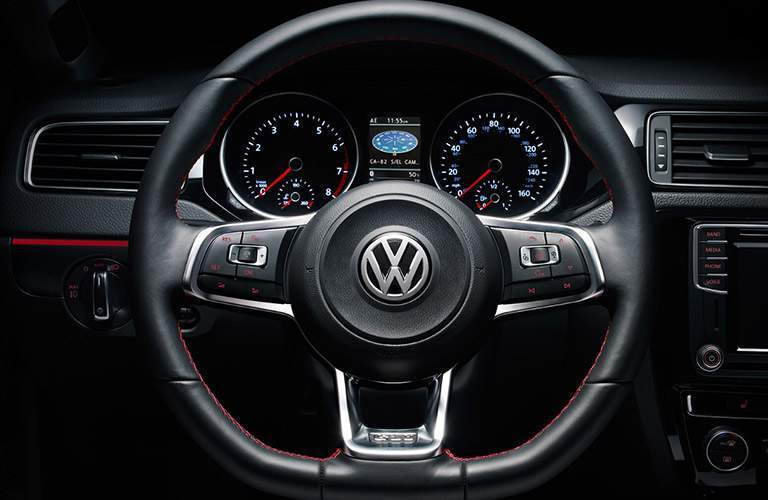 Closeup shot of 2018 Volkswagen Jetta steering wheel with instrument cluster visible