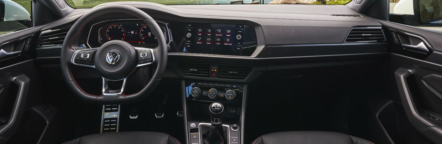 An interior photo of the front dashboard of the 2019 Volkswagen Jetta GLI.