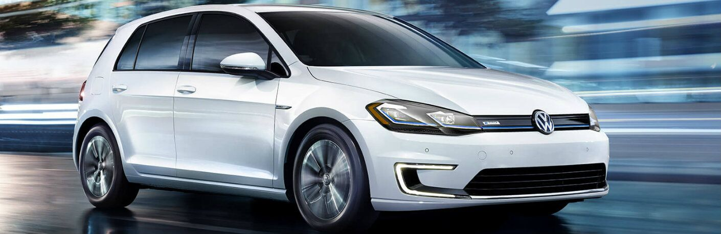 White 2017 Volkswagen e-Golf driving at night