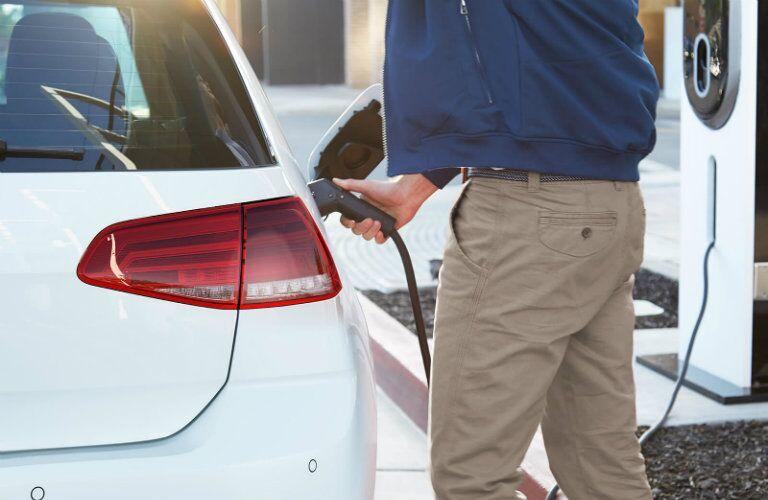 man charging a 2017 Volkswagen e-Golf