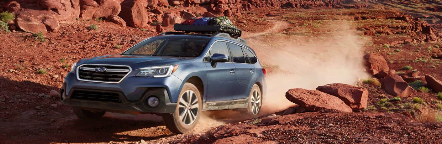 2018 Subaru Outback driving in the desert