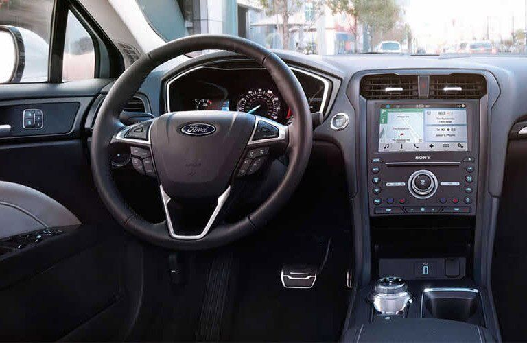 View of the 2017 Ford Fusion's steering wheel and dashboard
