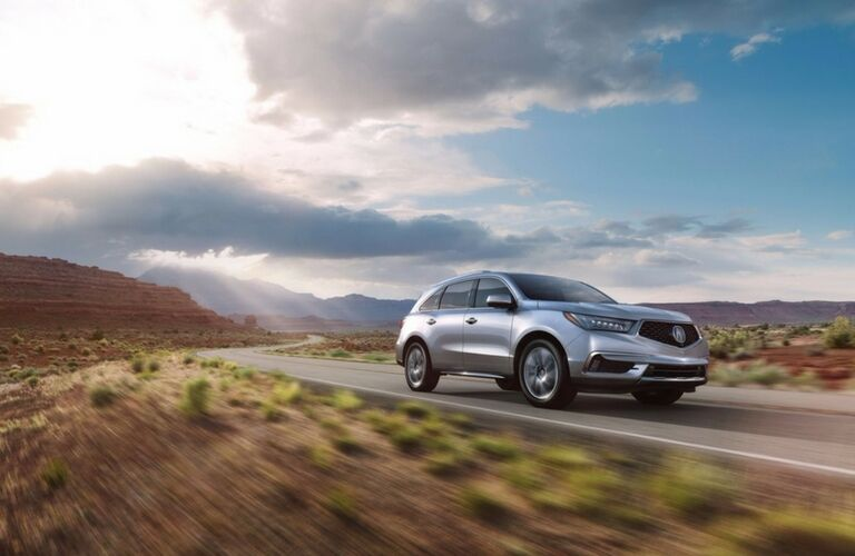 2017 Acura MDX driving down the highway