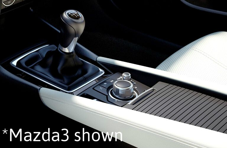 "closeup view of Mazda3 shift knob with text saying, ""Mazda3 shown"""