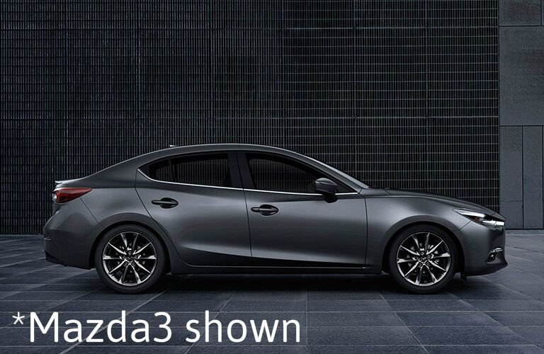 "side view of gray Mazda3 with text saying, ""Mazda3 shown"""