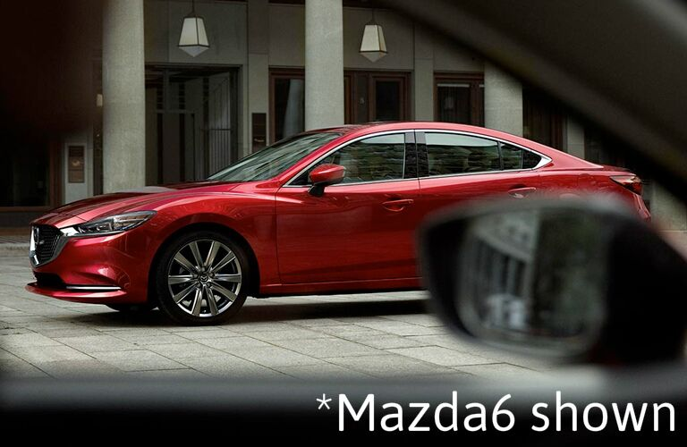 "red Mazda6 with text saying ""Mazda6 shown"""