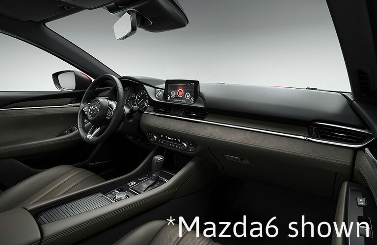 "interior view of Mazda6 dashboard and steering wheel with text saying, ""Mazda6 shown"""