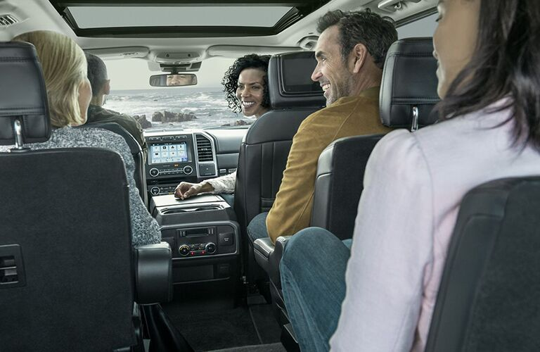Five people sitting inside the 2019 Ford Expedition talking