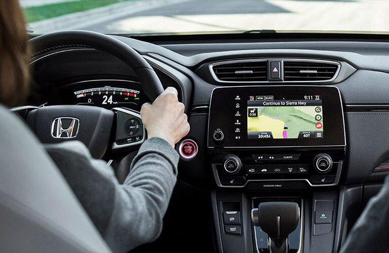A woman behind the wheel of the 2020 Honda CR-V